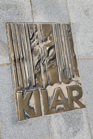 memorial plaque: The memorial plaque in brass on the sidewalk of famed Polish movie music composer Wojciech Kilar at Avenue of Stars on 16 August 2015 in Miedzyzdroje, Poland. Editorial