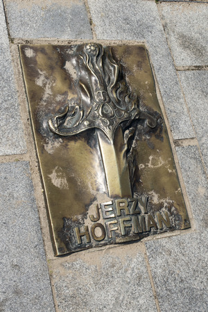 memorial plaque: The memorial plaque in brass on the sidewalk of famed Polish director Jerzy Hoffman movie at Avenue of Stars on 16 August 2015 in Miedzyzdroje, Poland.