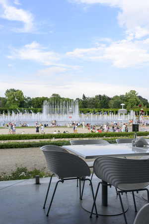 hottest: The view from the empty restaurant on people using public fountains cooling in the hottest day on 19 July 2015 in Wroclaw, Poland. In this year there was a record high temperature.