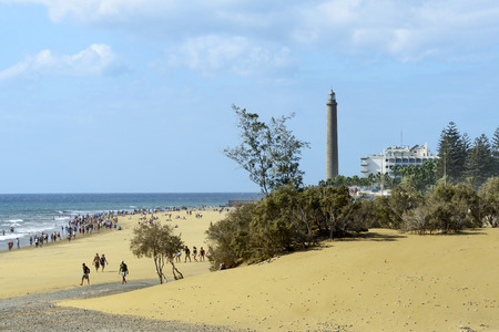 vacationing: Maspalomas sandy dunes with the walking vacationing people on 28 November 2015 in Maspalomas, Gran Canaria Island. Editorial
