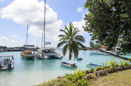 passe: View of the marina full of sailing boats in summer sunny day on 8 July 2015 in La Passe, La Digue Island, Seychelle.