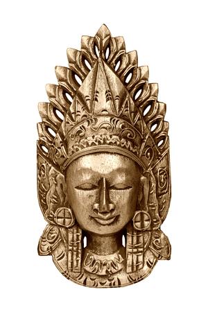 spiritual meditation creation: Gold wooden mask of god Vishnu isolated on white