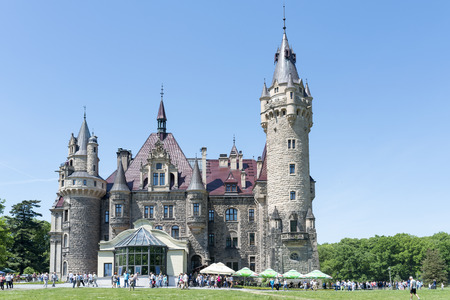 cloude: View of the Thiele-Winckler Palace on 22 May 2016 in the district Moszna, Poland. Tourists enjoying the beautiful weather visit the palace in Moszna. Editorial