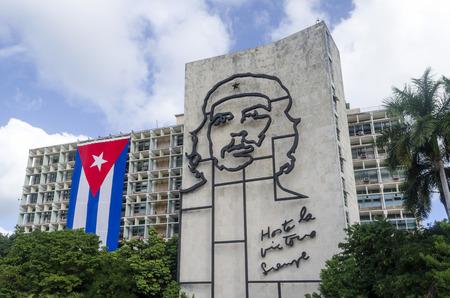 Cuban flag and relief of Che Guevara on facade of Ministry of Interior on the Plaza de la Revolucion on 29 November 2015 in Havana, Cuba. Guevara is a symbol of revolution of. Editorial