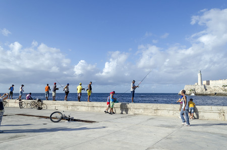 fishermen's: Cubans are fishermens fishing in the quay Malecon on 28 November 2015 in Havana, Cuba.