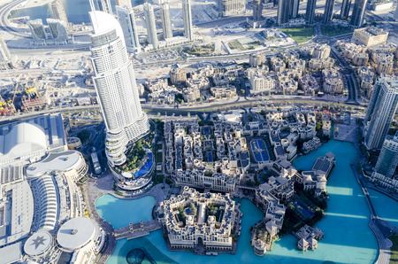 futuristic city: Dubai city, aerial view on a futuristic cityscape with modern new buildings. United Arab Emirates.