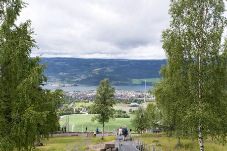 olympics: Tourists enjoying the beautiful weather watch from above the Olympic ski jump on June 27, 2016 in Lillehammer, Norway. Lillehammer City Winter Olympics in 1994.