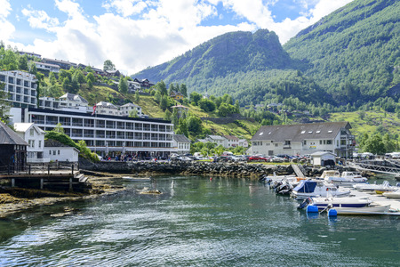 motorboats: Yachts and motorboats moored in Geirangerfjord sea port with tourists on June 29, 2016 in Geiranger, Norway. Geirangerfjord is famous place and UNESCO heritage site. Editorial