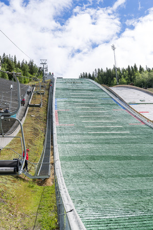 ski jump: Tourists enjoying the beautiful weather visit the ski jump on June 27, 2016 in Lillehammer, Norway. Lillehammer is the center of winter sports.