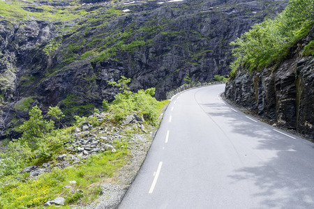 dangerous road: The Trollstigen road between the mountains, Norway. The most winding and dangerous road in Europe. Stock Photo
