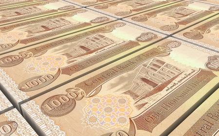 laundered: Iraqi dinars bills stacked background. 3D illustration.