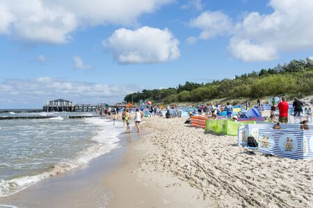 Tourists enjoy the sunny weather and relaxing on the Baltic sea beach on 15 August 2016 in Ustronie Morskie, Poland. Editorial