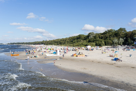 Tourists enjoy the sunny weather and relaxing on the Baltic sea beach on 15 August 2016 in Kolobrzeg, Poland. Editorial