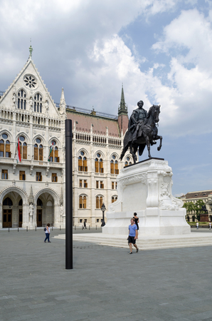 hungarian: Statue of Count Gyula Andrassy on the Parliament Square in front of Parliament Building on August 9 2015 in Budapest, Hungary. The Parliament is located on the bank of the Danube.