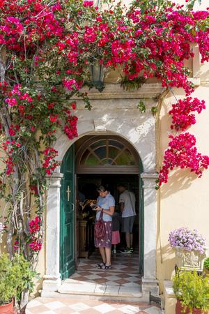 paleokastritsa: Tourists visit the Monastery of the Virgin Mary on May 15, 2017 in Paleokastritsa, Corfu island in Greece.