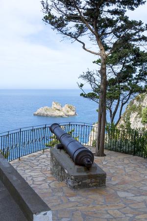 Old cannon in front of Monastery of Virgin Mary in Paleokastritsa, Corfu island in Greece.