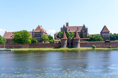 Medieval Teutonic Knights castle at Nogat river in Malbork, Poland
