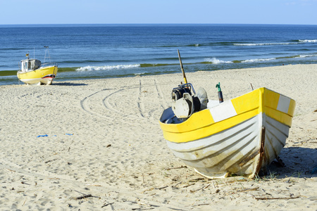 Fishing boats on Baltic Beach in Piaski near Krynica Morska, Poland