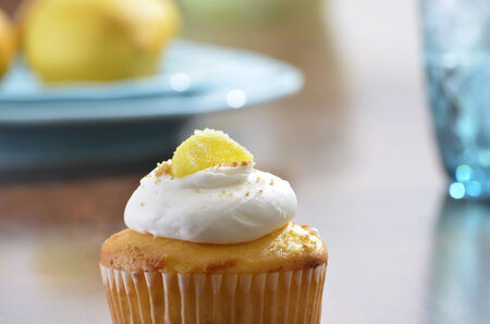 Lemon Cupcake with out of focus lemons on plate