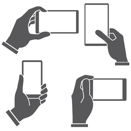 holding smart phone: hand holding and touching smartphone