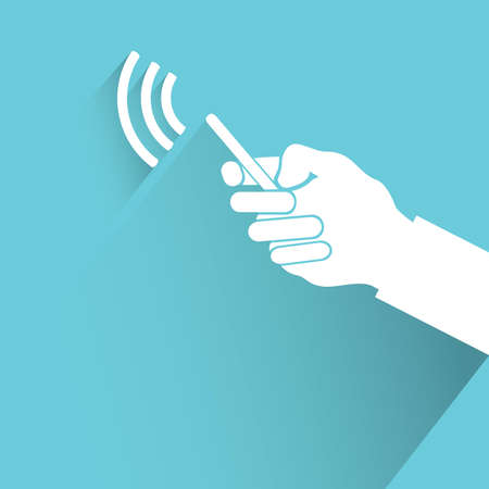 holding smart phone: hand holding smart phone on blue