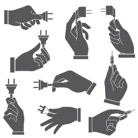 enchufe: mano que sostiene el enchufe eléctrico