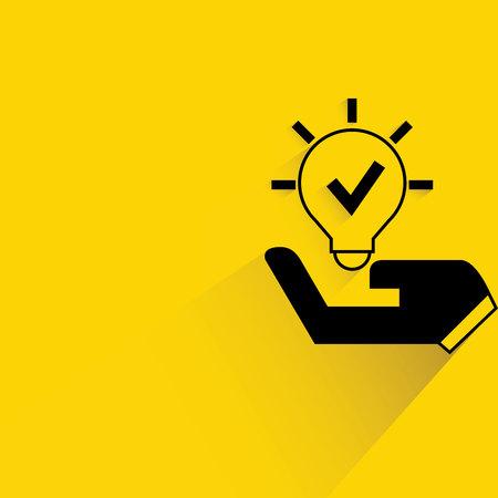envisage: hand holding light bulb