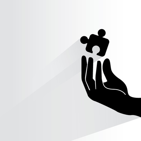 artifice: hand holding puzzle