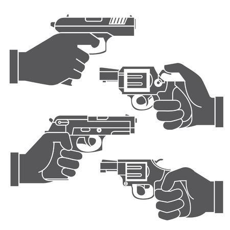 holding gun: hand holding gun