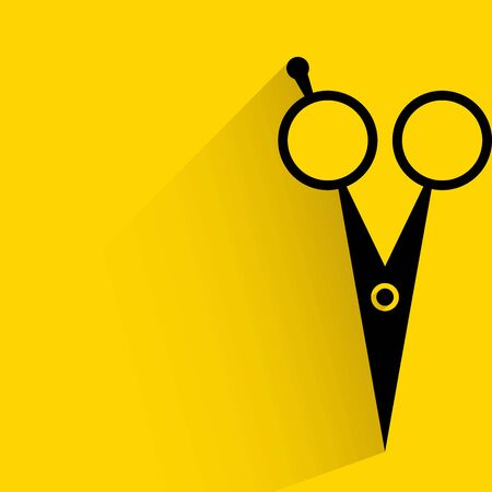 scissor on yellow background