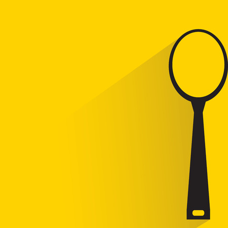 teaspoon: spoon and shadow on yellow background