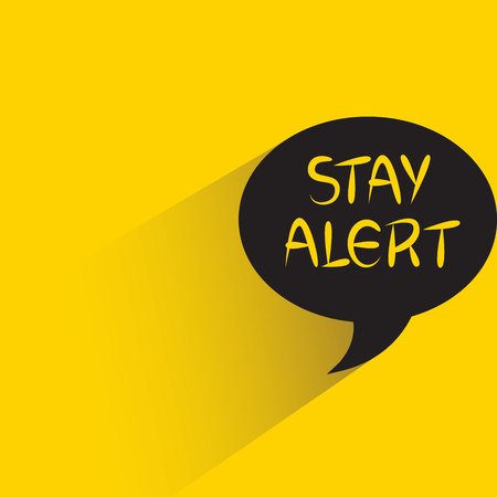 stay alert sign on yellow background