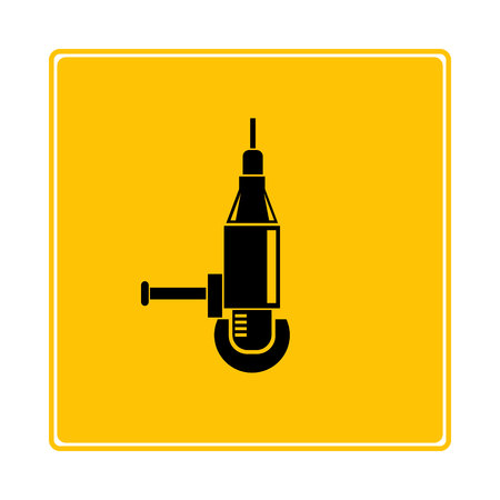 electric drill machine on yellow background