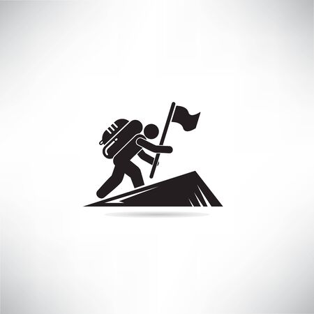 mountaineer climbing and holding flag to top of mountain