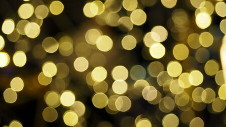 focus on background: Colorful blurred bokeh lights in the night time. Stock Photo