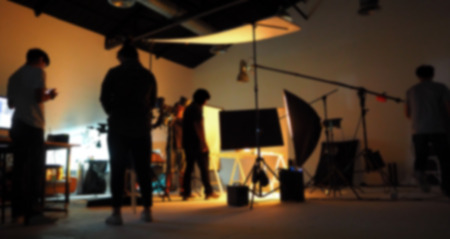 Blurred of production team shooting some video movie for tv commercial with studio equipment set.