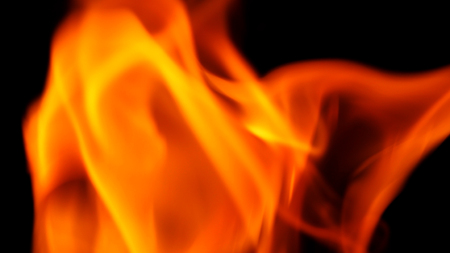 Abstract shape of fire close-up that burning with hot and danger on black background.