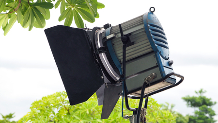 Production light equipment for video or movie shooting at outdoor location.