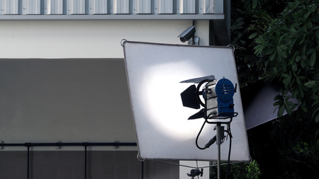 vdo: Big studio light and tripod for outdoor movie or video production shooting set. Stock Photo