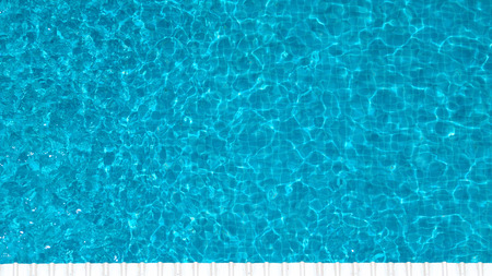 Swimming pool blue color clear water and people enjoying in summer sunny day and top view angle. Stockfoto