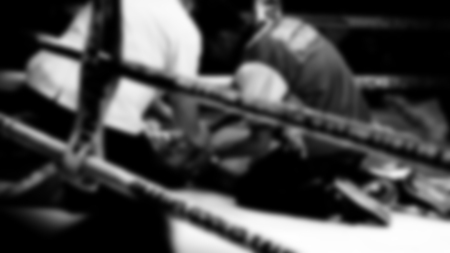 Blurred images black and white photo style of Thai boxing or Muay Thai or Kickboxing which local and foriegn boxer are fighting on the ring at indoor stadium stage as a martial art sport competition for traveller sightseeing