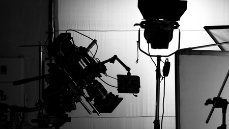 Video camera in film or movie production on tripod and professional gear which shooting in location or studio with crew team and beautiful prop or set and ready to online live broadcast or tv on air later Stock Photo - 122655603