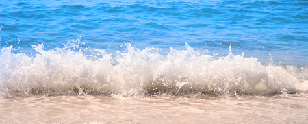 Clear light blue color sea water or liquid marine waving and splashing to light brown color sand beach on summer day in Pattaya Thailand and no people swimming because of hot weather. Stock fotó
