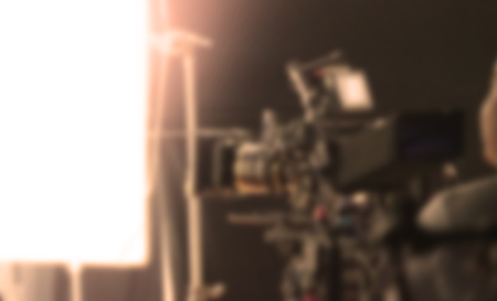 Blurry images of studio video shooting behind the scene or b-roll for online commercial and tvc which done by professional movie director film crew team and camera equipment with lighting set Stock Photo