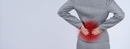 Business woman muscle suffering or painful from myositis or office syndrome or working which represent pain point by red gradient dot color and grey color suit and white background
