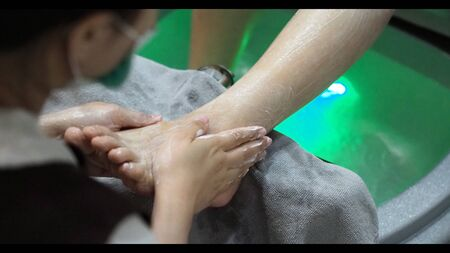 Close-up images of foot spa and leg massage and nail salon shop for woman which want to rest or relaxing from hard working and stress and want to be wellbeing healthy lifestyle treatment therapy.