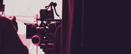 Colorful images of behind the scenes shooting production crew team and hd video camera equipment in studio which includes tripod, soft box light, monitors, lens for making film or movie or live broadcasting