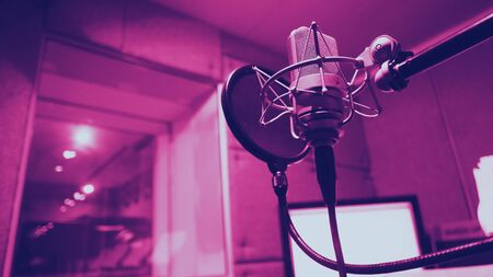 Sound production recording studio with microphone and shock mount and pop filter on tripod which use for vocalist or narrator or dj on brodcasting or professional creator live online channel  版權商用圖片