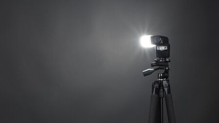 Studio light and back drop and soft box set up for shooting photo or video production which includes flashlight and continue lighting on tripod and paper background and used for photographer or videographer