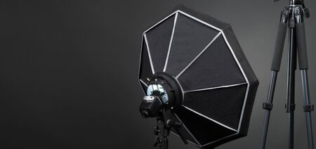 Studio light and back drop and soft box set up for shooting photo or video production which includes flashlight and continue lighting on tripod and paper background and used for photographer or videographer Banco de Imagens